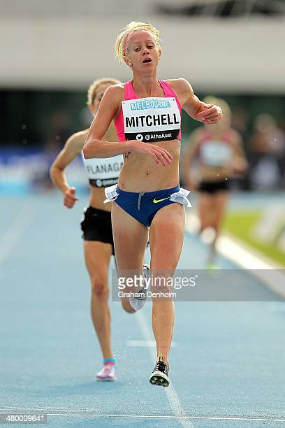 Victoria Mitchell of Australia crosses the line to win the Women's 3000 metres steeplechase open during the IAAF Melbourne World Challenge at Olympic...
