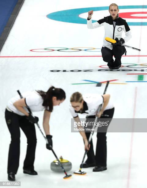 Victoria Moiseeva of Olympic Athlete from Russia directs Julia Guzieva and Galina Arsenkina in their game against Sweden during the Curling Women's...