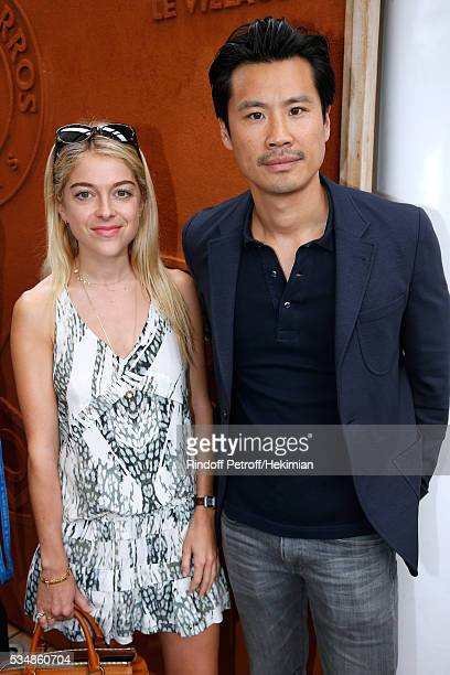 Victoria Monfort and actor Frederic Chau attend Day Seven of the 2016 French Tennis Open at Roland Garros on May 28 2016 in Paris France