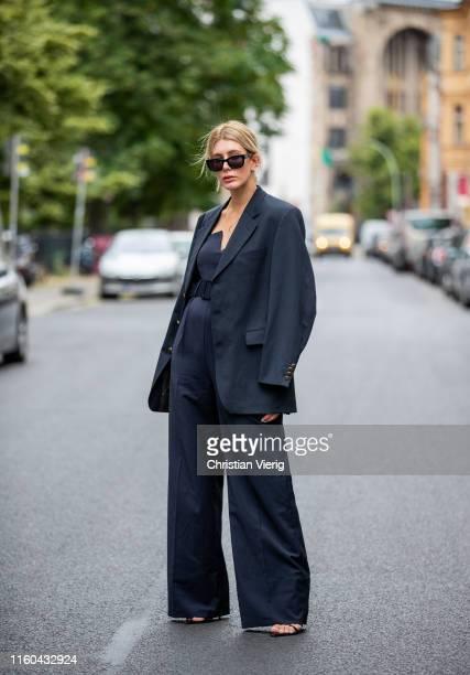 Victoria Nasir is seen wearing black wide leg overall COS vintage Ralph Lauren mens blazer on July 06 2019 in Berlin Germany