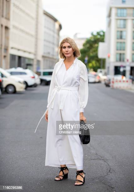 Victoria Nasir is seen wearing white dress black bag sandals outside Nobi Talai during Berlin Fashion Week on July 04 2019 in Berlin Germany