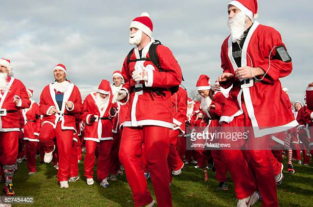 Victoria Park East London December 8th 2013 Santa Run in aid of different charities organised by 'Doitforcharity' pre run warmup exercises