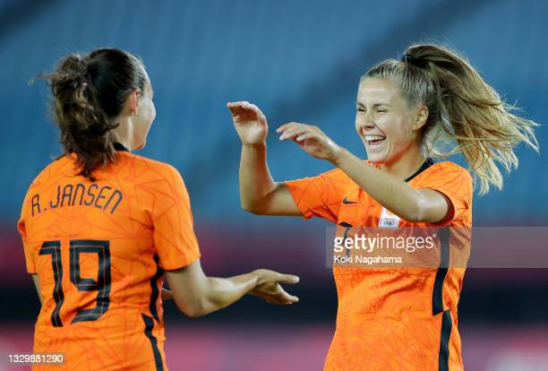 Victoria Pelova of Team Netherlands celebrates with teammate Renate Jansen after scoring their side's tenth goal during the Women's First Round Group...