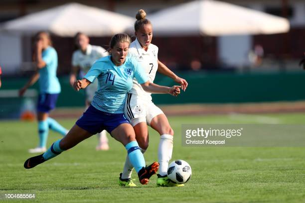 Victoria Pelova of the Netherlands challenges Giulia Gwinn of Germany during the friendly match between Germany U20 Girl's and the Netherlands at...