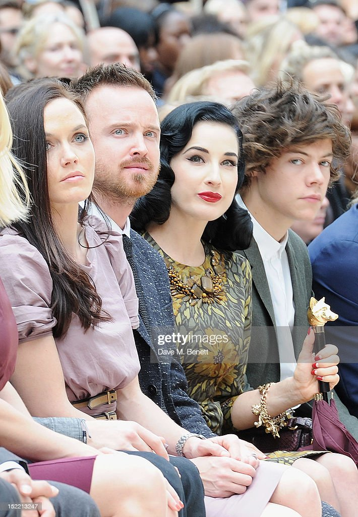 Victoria Pendleton, Aaron Paul, Dita Von Teese and Harry Styles attend the Burberry Spring Summer 2013 Womenswear Show Front Row at Kensington Gardens on September 17, 2012 in London, England.