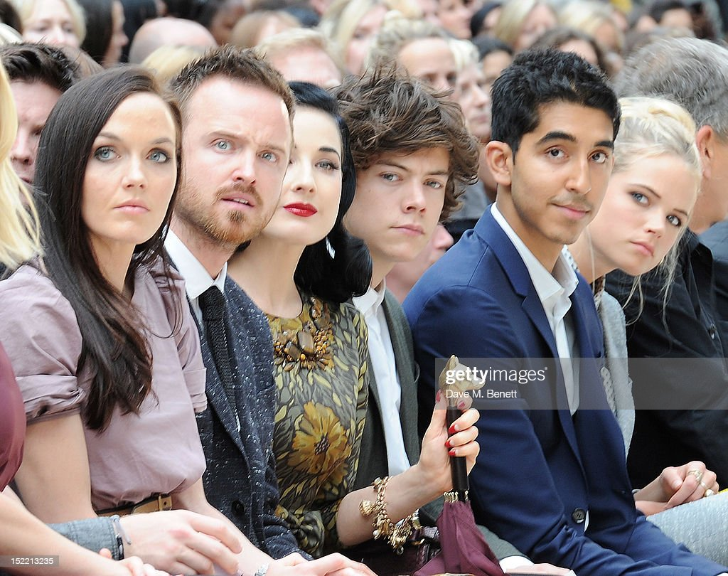 Victoria Pendleton, Aaron Paul, Dita Von Teese, Harry Styles, Dev Patel and Gabriella Wilde attend the Burberry Spring Summer 2013 Womenswear Show Front Row at Kensington Gardens on September 17, 2012 in London, England.