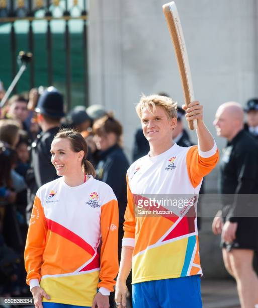 Victoria Pendleton and Cody Simpson carry the Commonwealth baton at the launch of The Queen's Baton Relay for the XXI Commonwealth Games being held...