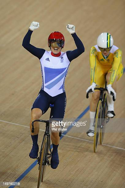 Victoria Pendleton of Great Britain celebrates in front of Anna Meares of Australia after winning gold in the Women's Keirin Track Cycling final on...