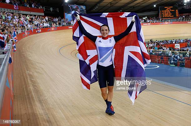 Victoria Pendleton of Great Britain celebrates with a Union Jack after winning gold in the Women's Keirin Track Cycling final on Day 7 of the London...