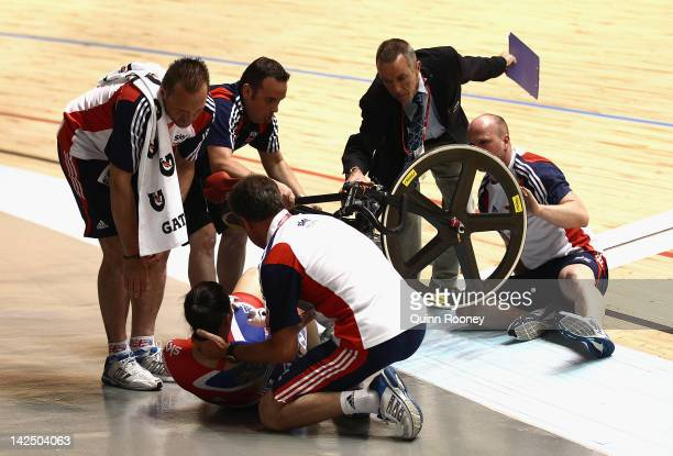 Victoria Pendleton of Great Britain is attended to after crashing in her Womens Sprint Semi Final race with Anna Meares of Australia during day three...