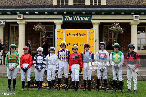 Victoria Pendleton poses with amateur jockeys before the Betfair novice flat amateur race at Ripon Races on August 31 2015 in Ripon England