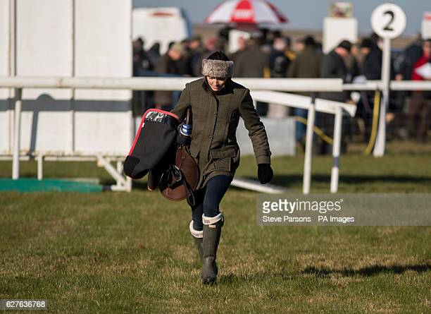 Victoria Pendleton runs with her saddle during a pointtopoint meeting at Barbury Castle Race course Wiltshire