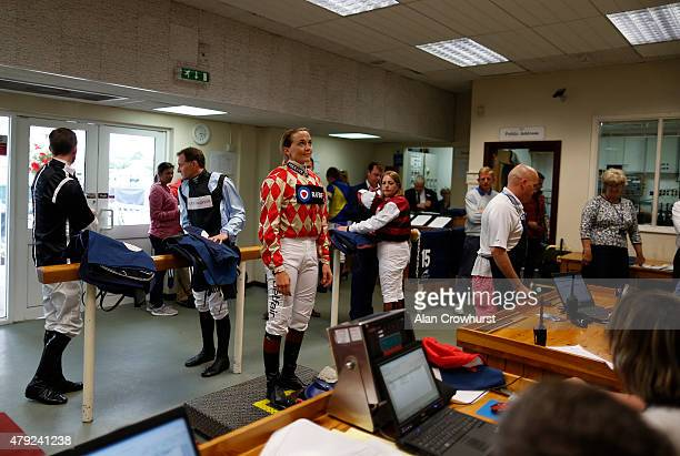 Victoria Pendleton the former Olympic cycling gold medalist on the scales in the weighing room before riding in The George Frewer Celebration...