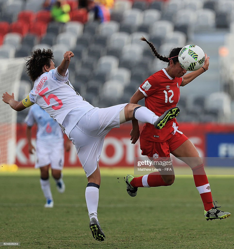 Victoria Pickett of Canada wins the ball from Ruka Norimatsu of Japan during the FIFA U-20 Women's World Cup Papua New Guinea 2016 Group B match between Canada and Japan at the National Football Stadium on November 20, 2016 in Port Moresby, Papua New Guinea.