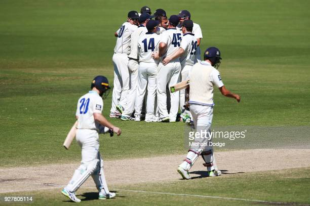 Victoria players celebrate winning after Peter Neville of New South Wales was stumped off the bowling of Fawad Ahmed of Victoria during day five of...