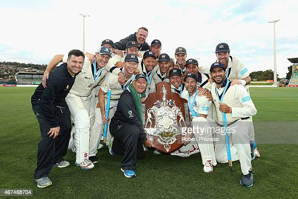 Victoria players pose for a team photo after a win during day five of the Sheffield Shield final match between Victoria and Western Australia at...