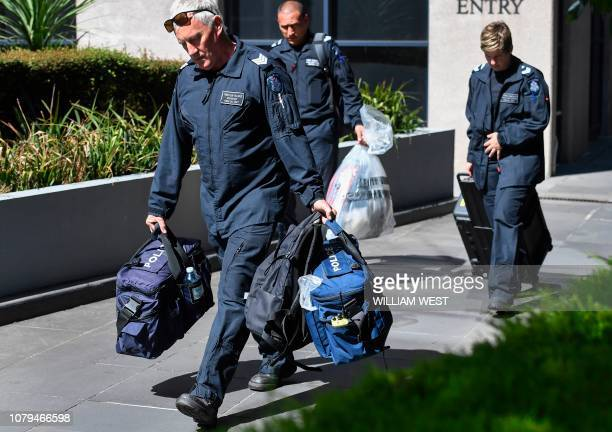 Victoria Police forensic officers remove a bag from the Italian consulate in Melbourne on January 9 2019 Australian police are investigating the...