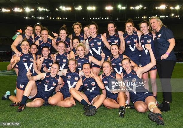 Victoria pose for a photo after winning the AFL Women's State of Origin match between Victoria and the Allies at Etihad Stadium on September 2 2017...