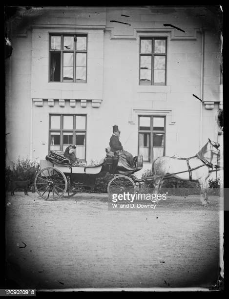 Victoria Queen of Great Britain travelling on a carriage in the grounds of Balmoral Castle a private royal residence near Ballater on the River Dee...