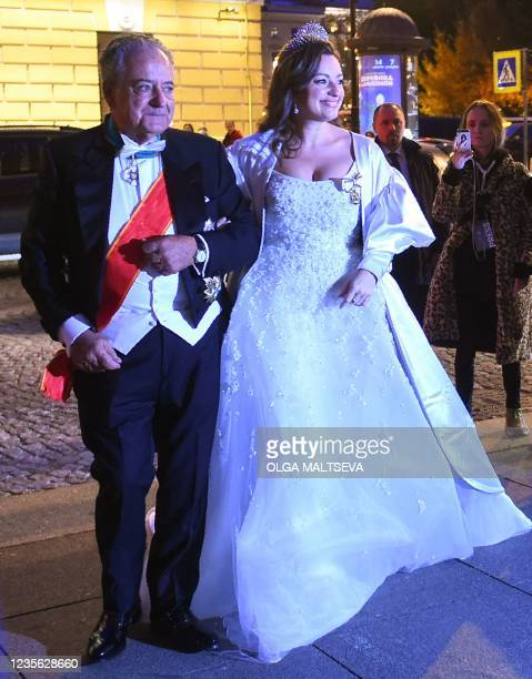 Victoria Romanovna Bettarini accompanied by her father, Roberto Bettarini, arrives to attend a dinner after her wedding with Grand Duke George...