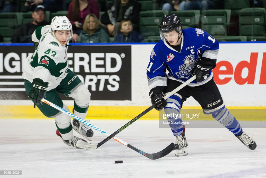 Victoria Royals captain Matthew Phillips (11) keeps the puck away from Connor Dewar (43) of the Everett Silvertips during a game between the Everett Silvertips and the Victoria Royals on January 7, 2018 at Angel of the Winds Arena in Everett, WA. Everett defeated Victoria by a final score of 9-4.