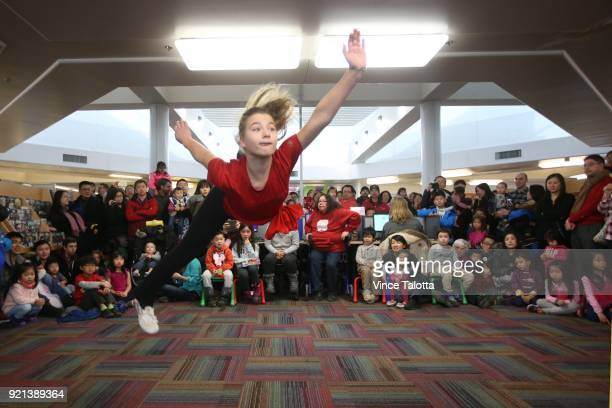 Victoria Rusakova member of Taishan School of Martial Arts performs a jump kick at Chinese New year festivities at Markham Milliken Mills Branch...