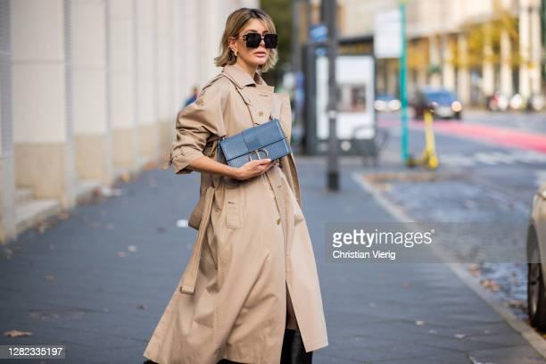 Victoria Scheu is seen wearing beige trench dress Nehera, trench coat Burberry, belt Dior, light blue bag Dior Montaigne, Dior sunglasses on October...