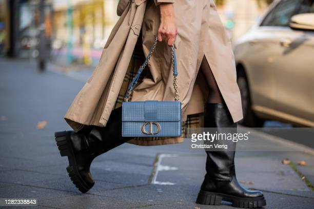 Victoria Scheu is seen wearing beige trench dress Nehera, trench coat Burberry, light blue bag Dior Montaigne, chunky boots Zara on October 26, 2020...