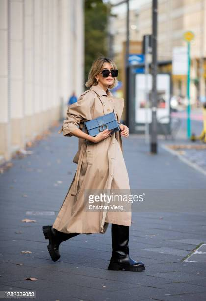 Victoria Scheu is seen wearing beige trench dress Nehera, trench coat Burberry, belt Dior, light blue bag Dior Montaigne, chunky boots Zara, Dior...