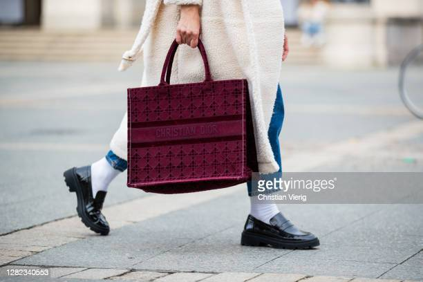 Victoria Scheu is seen wearing creme white shearling coat Sundaybay, high waist jeans Levis, chunky loafers with white socks Zara, red Shopper tottem...
