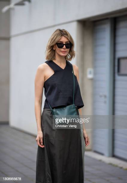 Victoria Scheu is seen wearing green bag Celine, Top Tibi, two tone skirt Peter Do, heels Zara on March 24, 2021 in Frankfurt am Main, Germany.