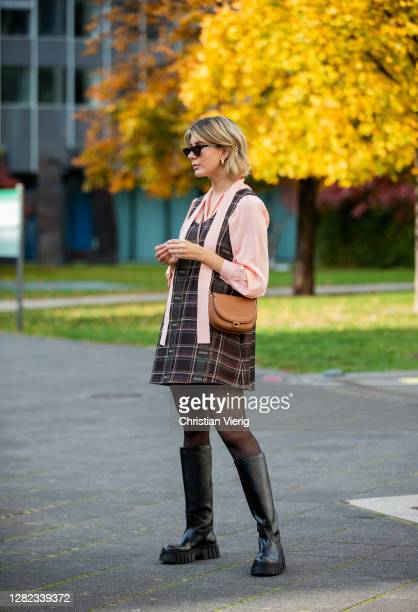 Victoria Scheu is seen wearing mini checkered dress and salmon colored bowtie blouse Nobi Talai sheer tights chunky Boots Zara cateye sunglasses...