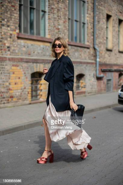 Victoria Scheu is seen wearing Satin skirt Kasha, Top Tibi, oversized Blazer Ralph Lauren , Plateau shoes Zara on March 24, 2021 in Frankfurt am...