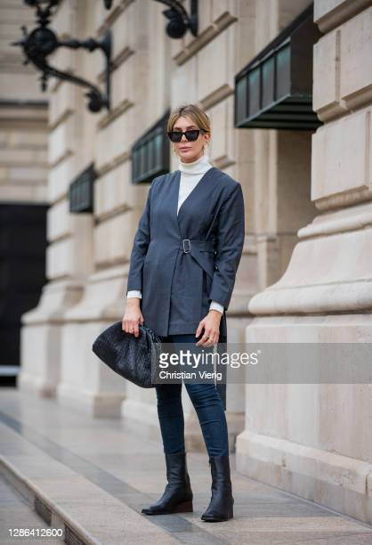 Victoria Scheu is seen wearing Skinny Jeans from Calvin Klein, square toe boots from COS, white turtleneck Hallhuber, Pouch Bag by Bottega Veneta,...