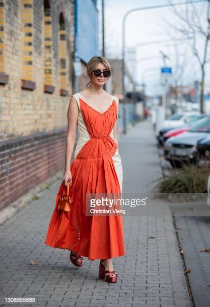 Victoria Scheu is seen wearing two tone dress Marni, orange bag Tory Burch on March 24, 2021 in Frankfurt am Main, Germany.