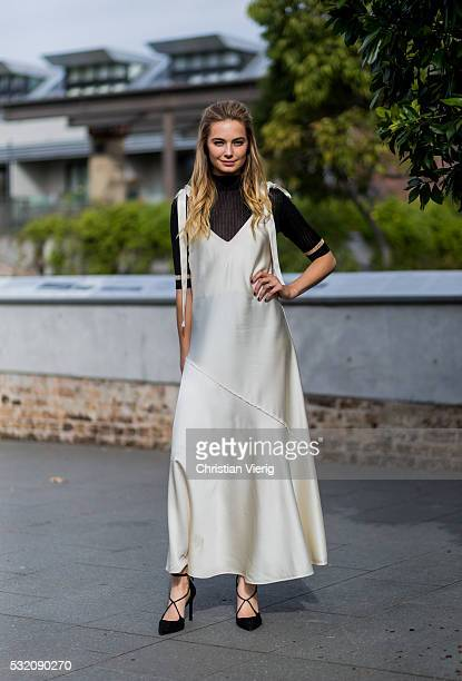 Victoria Secrets model Bridget Malcolm wearing a creme golden dress and laced heels outside Kitx at MercedesBenz Fashion Week Resort 17 Collections...