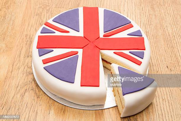 Victoria sponge cake with UK flag icing decoration