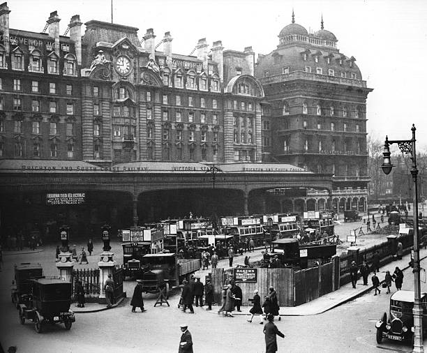 Exterior of Victoria Station, London with taxis and...