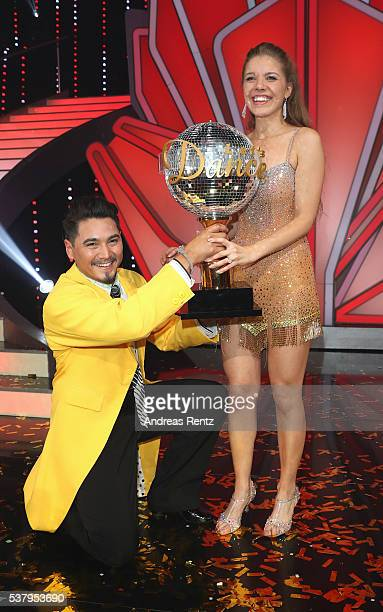 Victoria Swarovski and Erich Klann celebrate after winning the final show of the television competition 'Let's Dance' on June 3 2016 in Cologne...