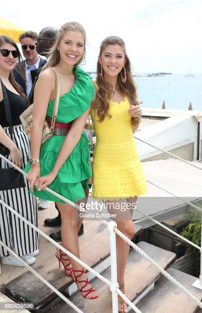 Victoria Swarovski and her sister Paulina Swarovski attend Magnum photocall during the 70th annual Cannes Film Festival at Magnum Beach on May 18...