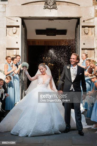 Victoria Swarovski and Werner Muerz exit the church after their wedding on June 16 2017 in Trieste Italy