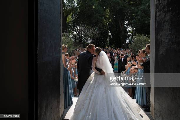 Victoria Swarovski and Werner Muerz kiss at their wedding on June 16 2017 in Trieste Italy