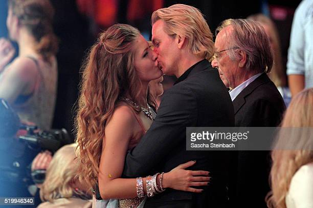 Victoria Swarovski kisses her fiance Werner Muerz during the 4th show of the television competition 'Let's Dance' at Coloneum on April 8 2016 in...