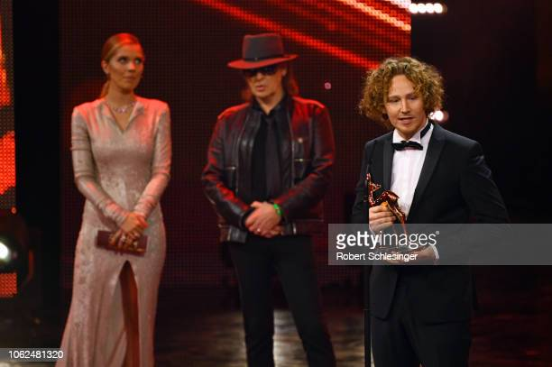 Victoria Swarovski Udo Lindenberg and Michael Schulte on stage during the 70th Bambi Awards show at Stage Theater on November 16 2018 in Berlin...