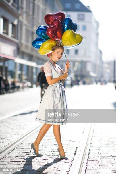 Victoria Swarovski wearing a dirndl from her collection with Krueger poses on the Promenaden Platz in front of the Hotel Bayerischer Hof on September...