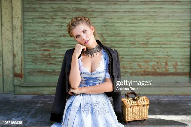 Victoria Swarovski wearing a dirndl from her collection with Krueger poses at the Viktualienmarkt on September 18 2018 in Munich Germany
