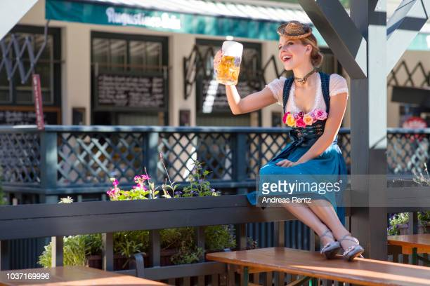 Victoria Swarovski wearing a dirndl from her collection with Krueger poses at the Wirtshaus am Bavariapark on September 18 2018 in Munich Germany