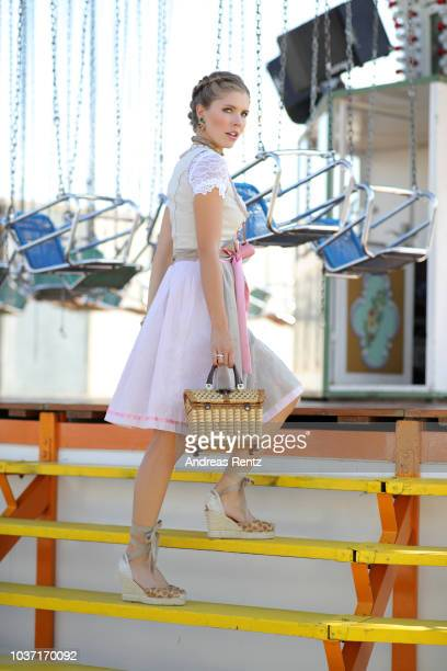 Victoria Swarovski wearing a dirndl from her collection with Krueger poses ahead of the Oktoberfest 2018 at Theresienwiese on September 18 2018 in...