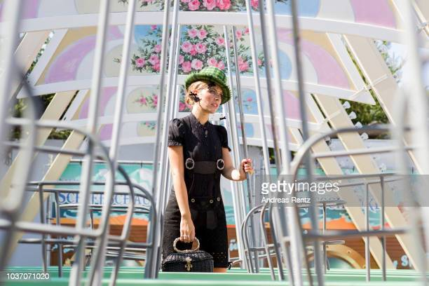 Victoria Swarovski wearing Krueger poses on a swing boat ahead of the Oktoberfest 2018 at Theresienwiese on September 18 2018 in Munich Germany