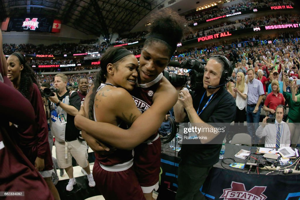 Victoria Vivians #35 and Teaira McCowan #15 of the Mississippi State Lady Bulldogs celebrate their 66-64 overtime win against the Connecticut Huskies during the semifinal round of the 2017 NCAA Women's Final Four at American Airlines Center on March 31, 2017 in Dallas, Texas.